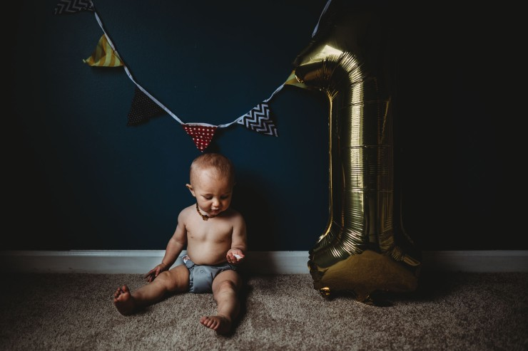a-one-year-old-boy-holding-paper-with-balloon